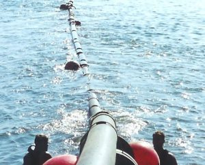 Subsea Diving Pipeline-Being-Pulled-Into-Harbour-Area-496x400